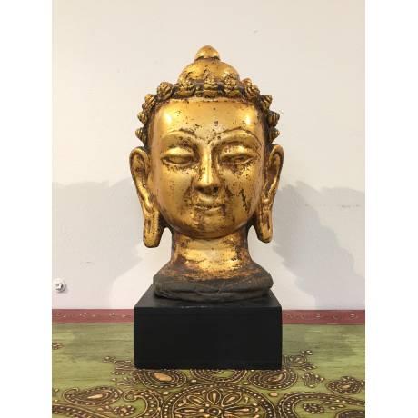 Tête de Bouddha dorée